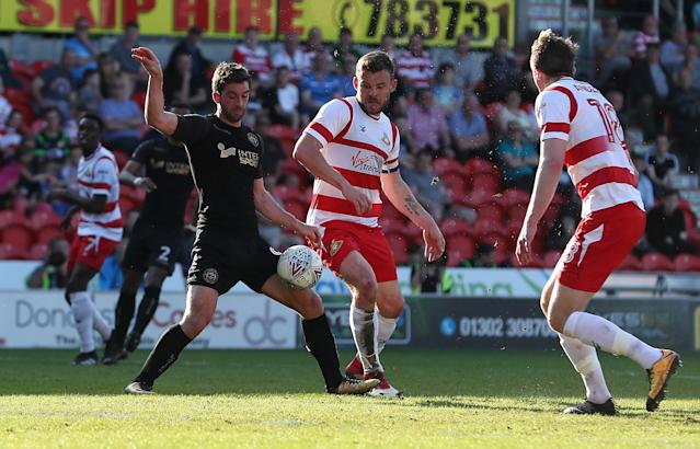 """Soccer Football - League One - Doncaster Rovers vs Wigan Athletic - Keepmoat Stadium, Doncaster, Britain - May 5, 2018 Wigan Athletic's Will Grigg in action with Doncaster Rovers' Andrew Butler Action Images/John Clifton EDITORIAL USE ONLY. No use with unauthorized audio, video, data, fixture lists, club/league logos or """"live"""" services. Online in-match use limited to 75 images, no video emulation. No use in betting, games or single club/league/player publications. Please contact your account representative for further details."""