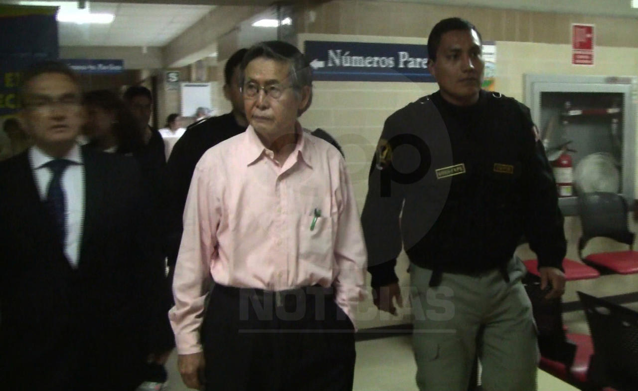 This June 9, 2011 frame grab taken from Peruvian cable news video RPP News, shows former Peru's President Alberto Fujimori, center, arriving at the The National Cancer Center in Lima, Peru. The doctor treating Fujimori says the jailed former Peruvian president has not suffered any major health setback and blamed his recent weight loss on depression. He says Fujimori lost 33 pounds (15 kilos) in four months and weighs 141 pounds (64 kilos). Fujimori is serving a 25-year prison sentence for rights abuses and corruption. Fujimori's daughter Keiko narrowly lost Peru's presidency in a runoff this month. (AP Photo/RPP News)