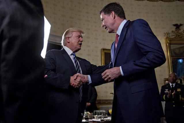 President Trump shakes hands with then-FBI Director James Comey during a reception at the White House in January. (Photo: Andrew Harrer-Pool/Getty Images)