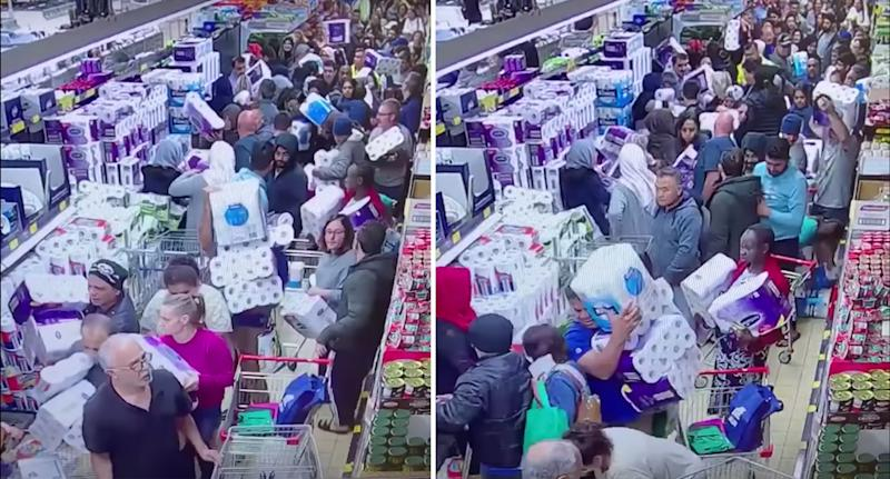 A sea of Aldi shoppers scramble madly to grab toilet paper.