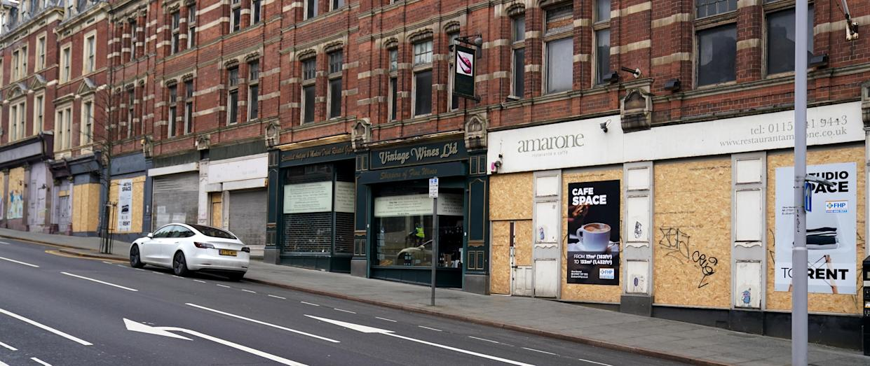 A row of boarded up shops in Nottingham City Centre during England's third national lockdown to curb the spread of coronavirus. Picture date: Friday February 19, 2021.