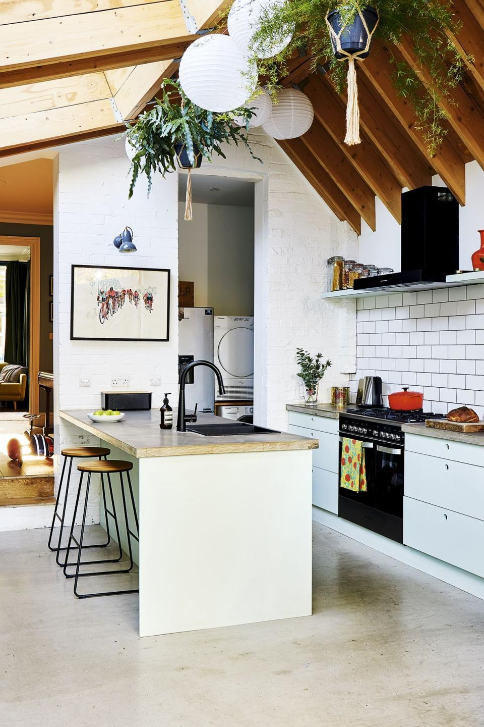 Kitchen extension with a glass roof and breakfast bar