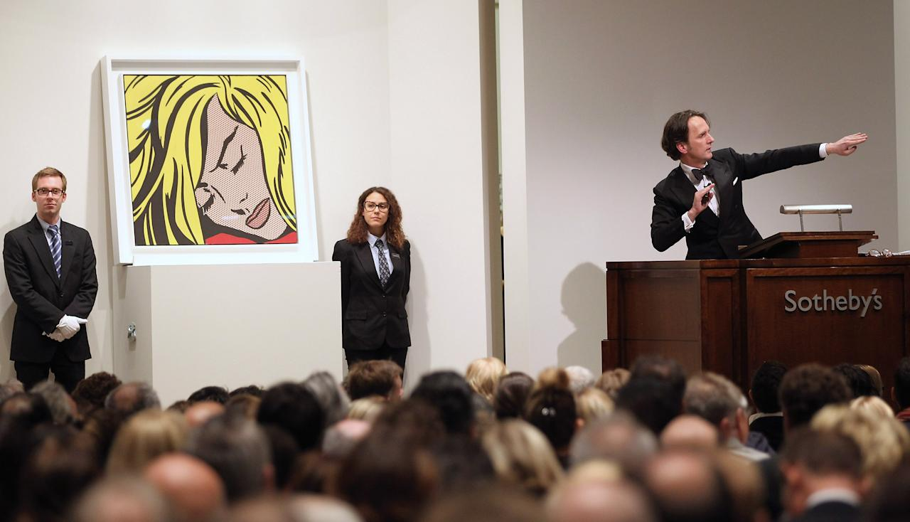 """NEW YORK, NY - MAY 09:  Roy Lichtenstein's 'Sleeping Girl' is auctioned at Sotheby's on May 9, 2012 in New York City. The market for contemporary art has been on fire in recent months with Edvard Munch's """"The Scream"""" posting an auction record of $119 million at Sotheby's on May 2. (Photo by Mario Tama/Getty Images)"""