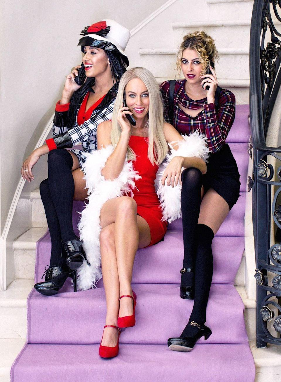 """<p>Got two friends and a few old-school cellphones? You're nearly ready to embody Cher, Dionne, and Tai—just add over-the-knee socks.</p><p><strong>Get the tutorial at <a href=""""https://www.sydnestyle.com/2017/10/clueless-halloween-group-diy-adult-costume-idea/"""" rel=""""nofollow noopener"""" target=""""_blank"""" data-ylk=""""slk:Sydne Style"""" class=""""link rapid-noclick-resp"""">Sydne Style</a>.</strong></p><p><a class=""""link rapid-noclick-resp"""" href=""""https://go.redirectingat.com?id=74968X1596630&url=https%3A%2F%2Fwww.walmart.com%2Fsearch%2F%3Fquery%3Dknee%2Bsocks&sref=https%3A%2F%2Fwww.thepioneerwoman.com%2Fhome-lifestyle%2Fcrafts-diy%2Fg37066817%2Fhalloween-costumes-for-3-people%2F"""" rel=""""nofollow noopener"""" target=""""_blank"""" data-ylk=""""slk:SHOP KNEE SOCKS""""><strong>SHOP KNEE SOCKS</strong></a></p>"""