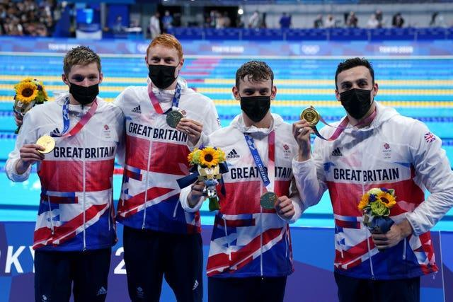 The quartet picked up their medals