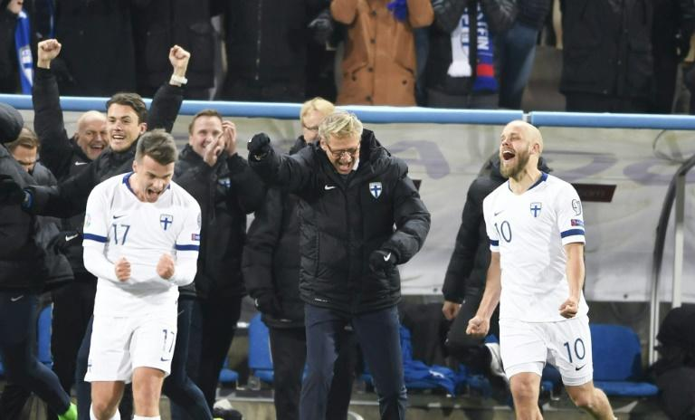 Finland celebrate qualifying for their first appearance at the finals of a major tournament (AFP Photo/Martti Kainulainen)