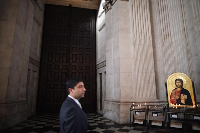 LONDON, ENGLAND - APRIL 15: A visitor walks past the 'Great West Door' inside St Paul's Cathedral ahead of the funeral of former British Prime Minister Margaret Thatcher on April 15, 2013 in London, England. On Wednesday April 17, over 2,000 guests including global political figures and celebrities will attend the funeral of Margaret Thatcher at St Paul's Cathedral. The service will include 700 serving Armed Forces personnel, and will be led by the Band of the Royal Marines. The 87 year-old former prime minister died after suffering a stroke on April 8. (Photo by Dan Kitwood/Getty Images)