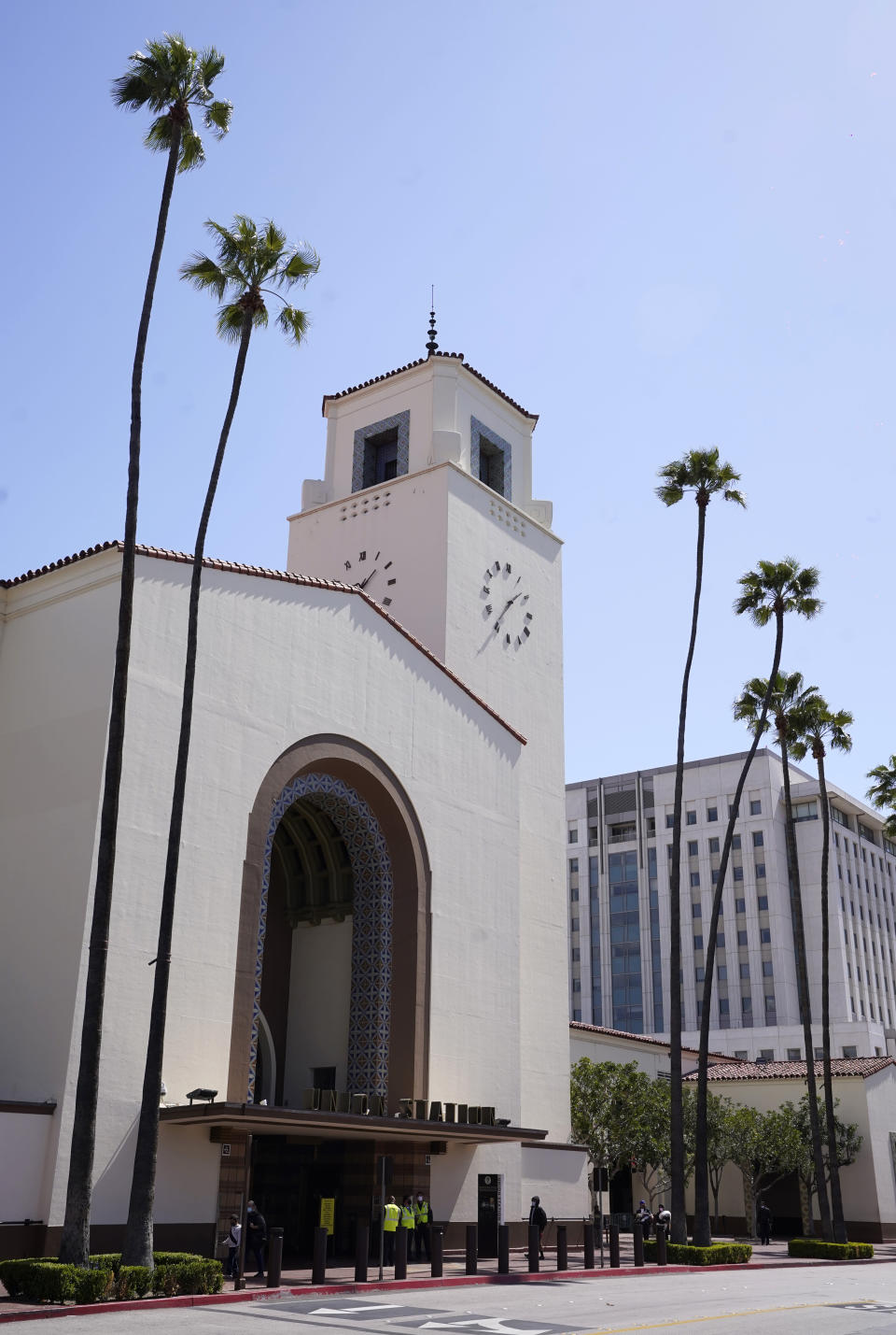 The exterior of Union Station in Los Angeles appears on March 23, 2021. The Oscars are headed to the historic site for the first time this year. With wide open spaces and 65-foot high ceilings, it's ideal for a big crew and cameras. It's been used in car commercials, reality shows and procedurals. But its beamed ceilings, Spanish tile floors and regal bronze chandeliers really shine in cinema where it's played train stations, banks, police stations, clubs and airports. (AP Photo/Chris Pizzello)