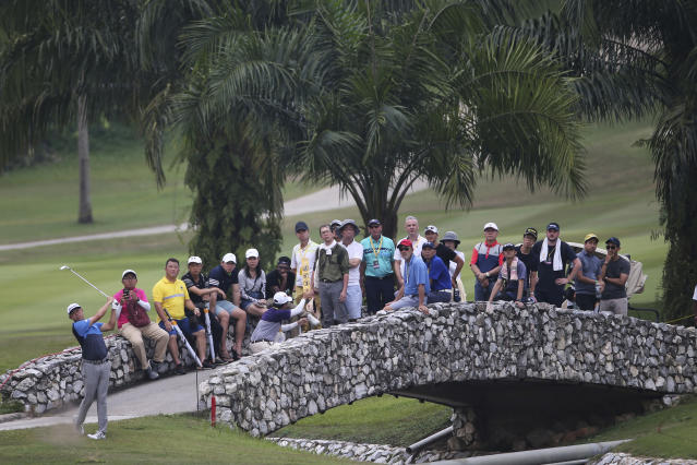 David Lipsky of the United States plays a shot at 6th hole at the final round of the Malaysia Golf Championship in Kuala Lumpur, Malaysia, Sunday, March 24, 2019. (AP Photo/Vincent Phoon)