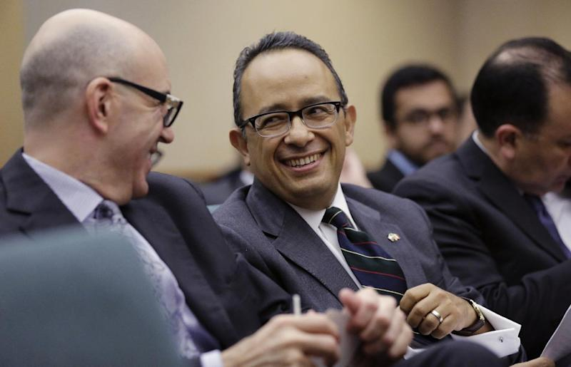 Carlos Gonzalez Gutierrez, center, Mexico's consul general in Austin, waits to give testimony to the Committee on International Trade and Intergovernmental Affairs at the Texas Capitol, Monday, March 6, 2017, in Austin, Texas. Officials from Mexico and Texas are urging the state's lawmakers to defend the North American Free Trade Agreement against President Donald Trump's administration, which has been wary of it. (AP Photo/Eric Gay)
