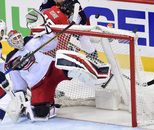 Columbus Blue Jackets goaltender Sergei Bobrovsky (72), of Russia, watches the puck sail over the net during overtime in Game 2 of an NHL first-round hockey playoff series against the Washington Capitals, Sunday, April 15, 2018, in Washington. The Blue Jackets won 5-4 in overtime. (AP Photo/Nick Wass)