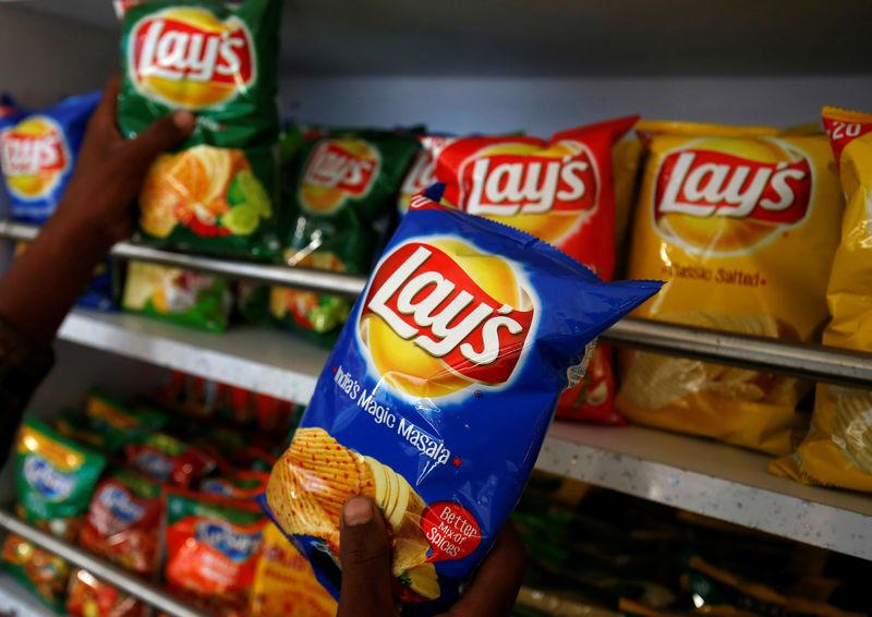 A customer picks packets of Lay's potato chips at a shop in Ahmedabad