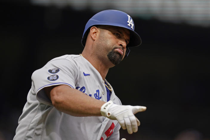 Los Angeles Dodgers' Albert Pujols points as he rounds the bases after hitting a solo home run in the ninth inning of a baseball game against the Atlanta Braves, Sunday, June 6, 2021, in Atlanta. (AP Photo/Brynn Anderson)