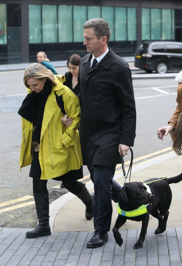Lord Holmes of Richmond was helped from the dog by his wife and alongside his guide dog (Philip Toscano/PA)