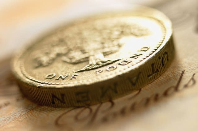 Close up of British pound coin and currency