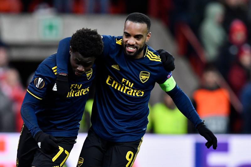 Arsenal's English striker Bukayo Saka (L) celebrates with Arsenal's French striker Alexandre Lacazette after scoring during the UEFA Europa League Group F football match between R. Standard de Liege and Arsenal FC at the Maurice Dufrasne Stadium in Sclessin on December 12, 2019. (Photo by JOHN THYS / AFP) (Photo by JOHN THYS/AFP via Getty Images)