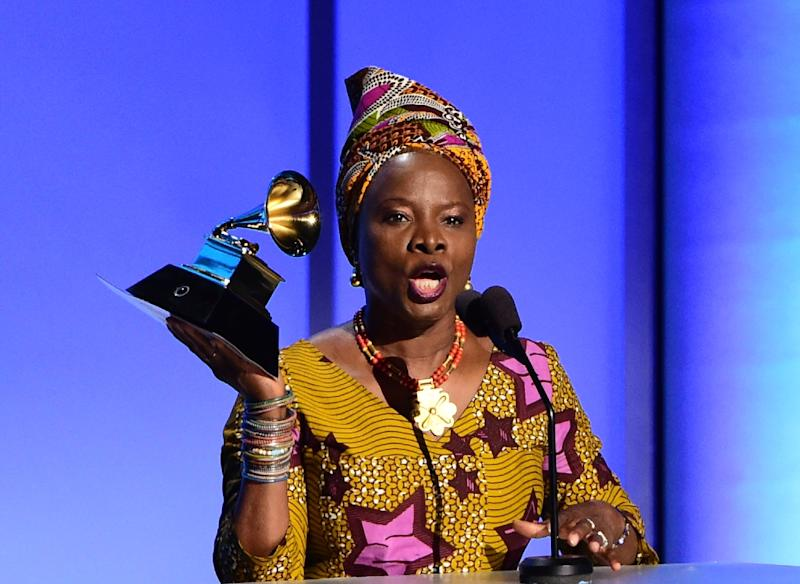 Angelique Kidjo recieves the award for the Best World Music Album, Sings, onstage during the 58th Annual Grammy music Awards in Los Angeles on February 15, 2016 (AFP Photo/Robyn Beck)