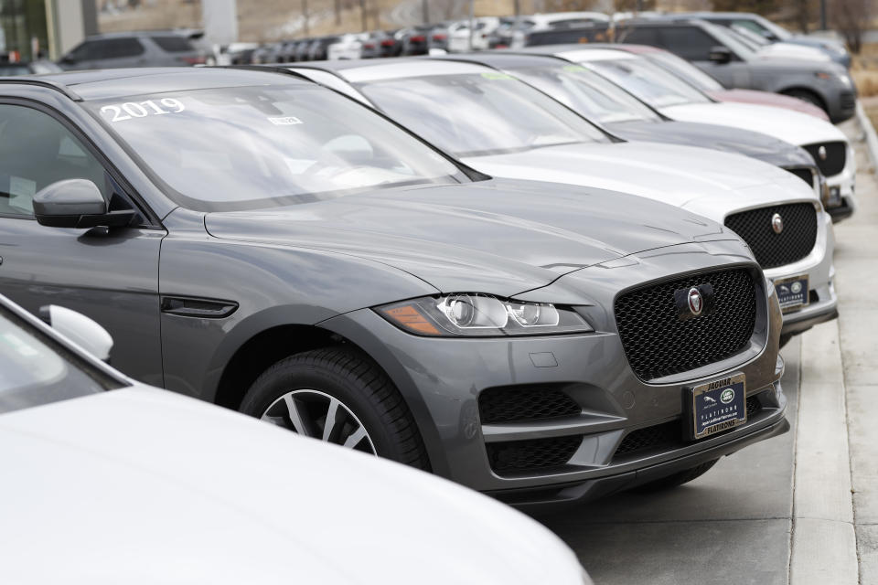 FILE-In this Sunday, Feb. 17, 2019, file photograph, unsold Jaguar F-Pace sports utility vehicles sit in a long row at an Audi Jaguar Land Rover dealership in Broomfield, Colo. (AP Photo/David Zalubowski)