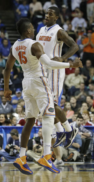 Florida forward Will Yeguete (15) and Florida guard Kenny Boynton (1) reacts after a Florida goal to move ahead of Alabama during the second half of an NCAA college basketball game in the semifinals of the Southeastern Conference tournament, Saturday, March 16, 2013, in Nashville, Tenn. (AP Photo/John Bazemore)