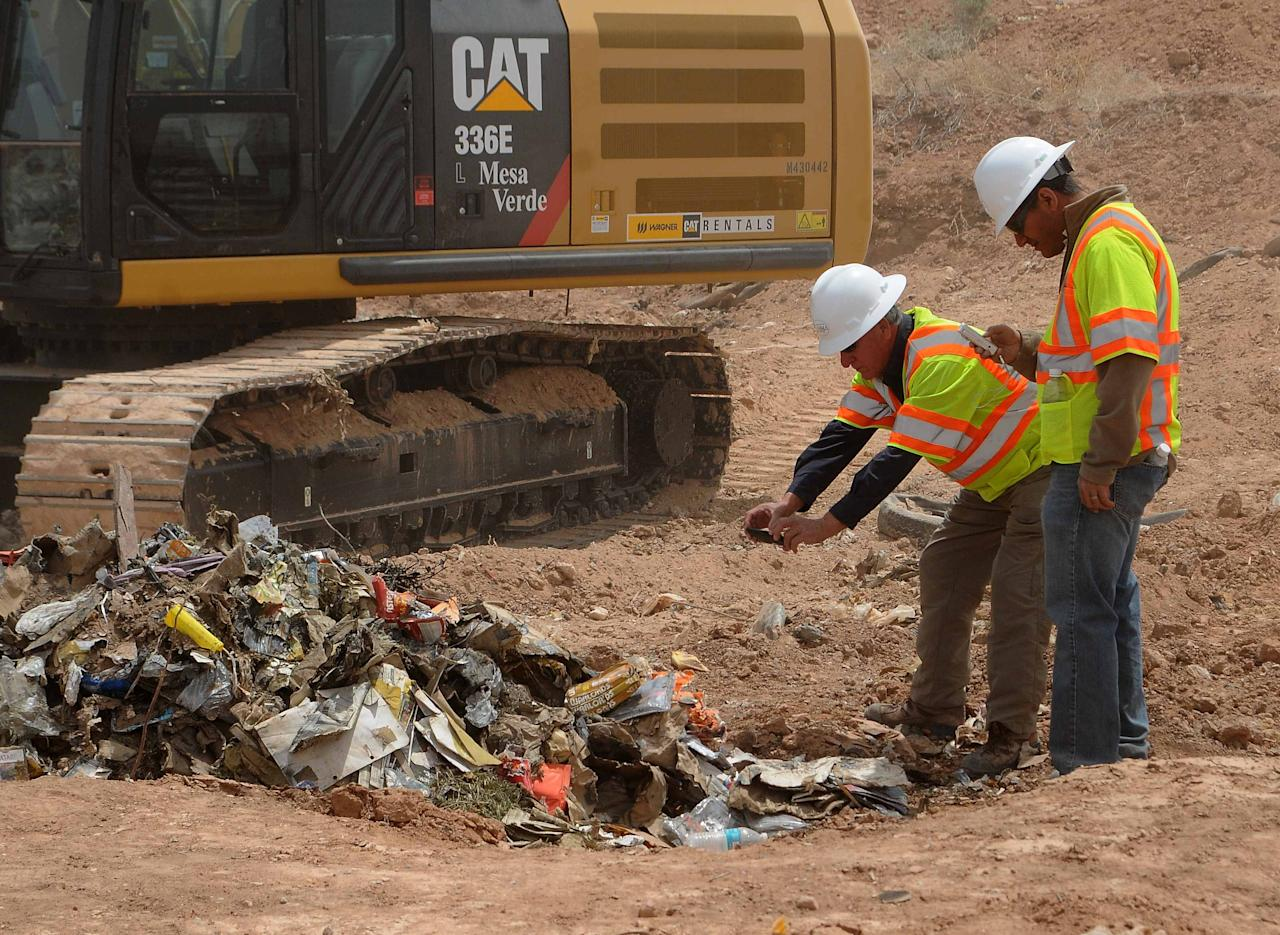 "Workers take photos of recovered Atari games at the old Alamogordo landfill in Alamogordo, New Mexico, April 26, 2014. Documentary filmmakers digging in a New Mexico landfill on Saturday unearthed hundreds of ""E.T. the Extra-Terrestrial"" cartridges, considered by some the worst video game ever made and blamed for contributing to the downfall of the video game industry in the 1980s. REUTERS/Mark Wilson (UNITED STATES - Tags: ENTERTAINMENT SCIENCE TECHNOLOGY SOCIETY)"
