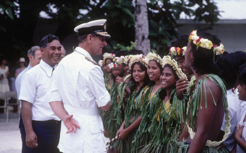 Prince Philip engaged in many overseas Royal Tours – pictured here on the island of Kiribati in 1983 - Getty