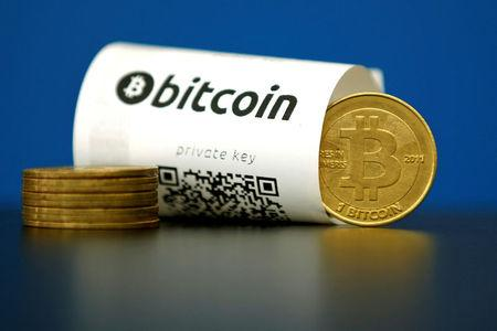 FILE PHOTO - An illustration photo shows a Bitcoin (virtual currency) paper wallet with QR codes and a coin are seen at La Maison du Bitcoin in Paris