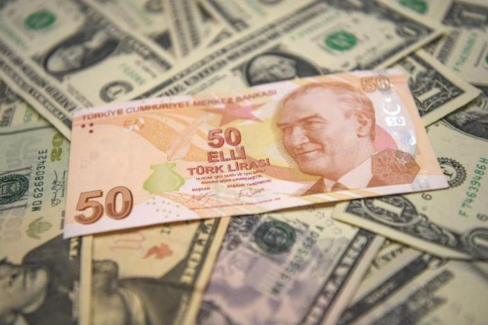 The Turkish lira is at record lows against the dollar (AFP Photo/OZAN KOSE)