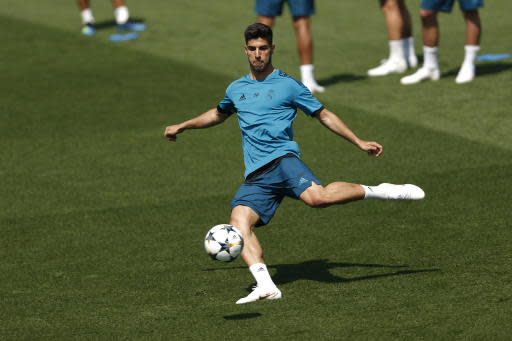 """In this May 22, 2018 file photo, Real Madrid's Marco Asensio shoots the ball during a training session at the team's Veldebebas training ground in Madrid, Spain. With Spain's golden generation all but gone, it's up to a group of talented youngsters that include Marco Asensio and Francisco """"Isco"""" Alarcon to try to take over the Spanish national team and lead La Roja back to its glory days. (AP Photo/Francisco Seco, File)"""