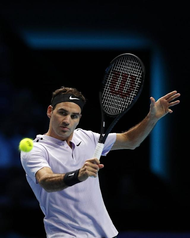 Switzerland's Roger Federer plays a backhand shot against US Jack Sock during their men's singles match in the ATP World Tour Finals at the O2 Arena in London on November 12, 2017 (AFP Photo/ADRIAN DENNIS)