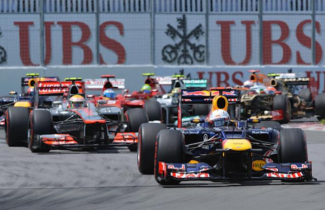 Red Bull Racing driver Sebastian Vettel of Germany leads into the second turn at the start of the Canadian Formula One Grand Prix on June 10, 2012 at the Circuit Gilles Villeneuve in Montreal. AFP PHOTO/Stan HONDASTAN HONDA/AFP/GettyImages