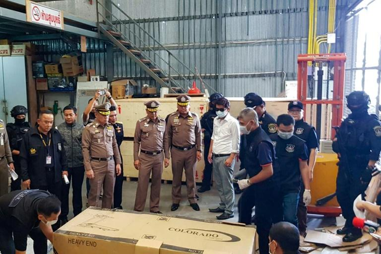 "Thailand's narcotics police found 36 kilograms (79 pounds) of crystallised methamphetamine known as ""ice"" hidden in the metal frames of treadmills about to be shipped to Japan, while another 122 kilograms (25 pounds) were stored in cardboard boxes (AFP Photo/Handout)"