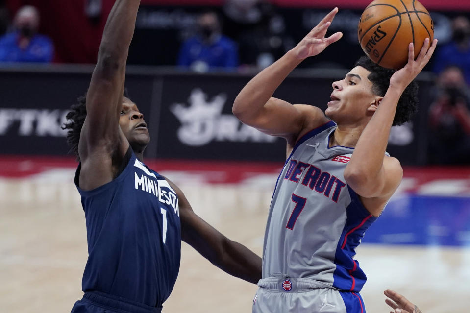 Detroit Pistons guard Killian Hayes (7) shoots over the defense of Minnesota Timberwolves forward Anthony Edwards (1) during the second half of an NBA basketball game, Tuesday, May 11, 2021, in Detroit. (AP Photo/Carlos Osorio)