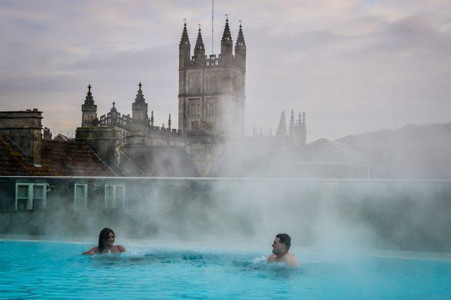 Steam rises above the hot natural spring waters Bath