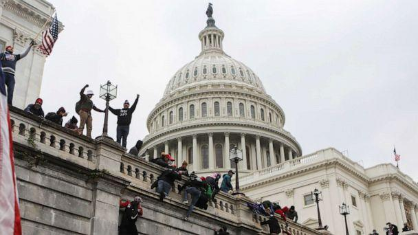 PHOTO: Supporters of President Donald Trump climb on walls at the U.S. Capitol during a protest against the certification of the 2020 U.S. presidential election results by Congress, in Washington, Jan. 6, 2021. (Jim Urquhart/Reuters)