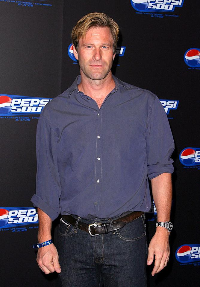 """""""The Dark Knight's"""" dashing D.A. Aaron Eckhart looks pretty good out of a suit. Jordan Strauss/<a href=""""http://www.wireimage.com"""" target=""""new"""">WireImage.com</a> - August 27, 2008"""