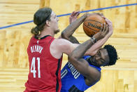 Houston Rockets forward Kelly Olynyk (41) and Orlando Magic forward Robert Franks, right, battle for possession of the ball during the first half of an NBA basketball game, Sunday, April 18, 2021, in Orlando, Fla. (AP Photo/John Raoux)