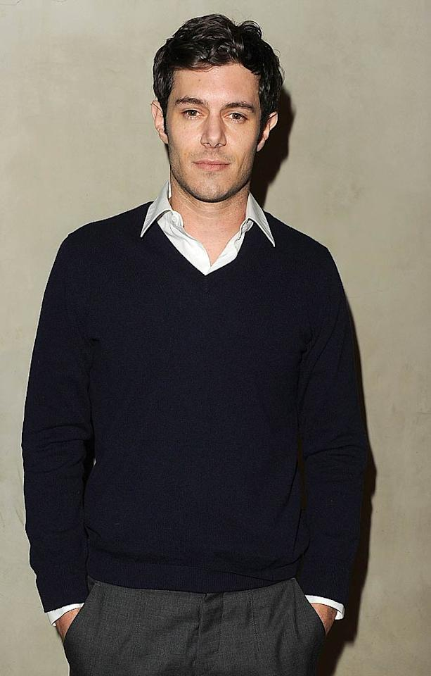 "Former star of ""The O.C."" Adam Brody kept it casual (and a bit dorky, if you ask us!) in a navy sweater and gray slacks.   Jason Merritt/GettyImages.com - October 11, 2011"