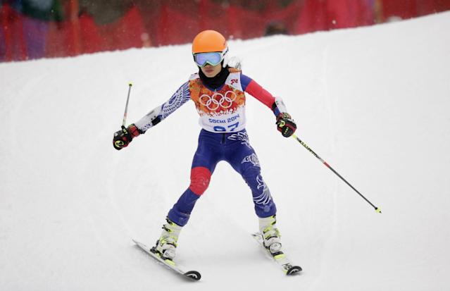 Violinst Vanessa Mae, starting under her father's name as Vanessa Vanakorn for Thailand, competes in the first run of the women's giant slalom at the Sochi 2014 Winter Olympics, Tuesday, Feb. 18, 2014, in Krasnaya Polyana, Russia. (AP Photo/Charles Krupa)