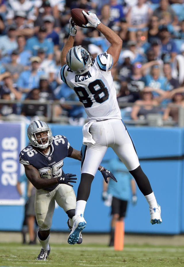 Carolina Panthers' Greg Olsen (88) catches a pass as Dallas Cowboys' Kavon Frazier (35) defends during the first half of an NFL football game in Charlotte, N.C., Sunday, Sept. 9, 2018. (AP Photo/Mike McCarn)