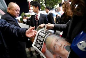 Mandatory Credit: Photo by Aflo/REX/Shutterstock (7427223k) A newspaper staff hands out an extra edition in downtown Tokyo announcing Donald Trump's election as the 45th president of the United States of America Reaction to the US presidential election results, Tokyo, Japan - 09 Nov 2016