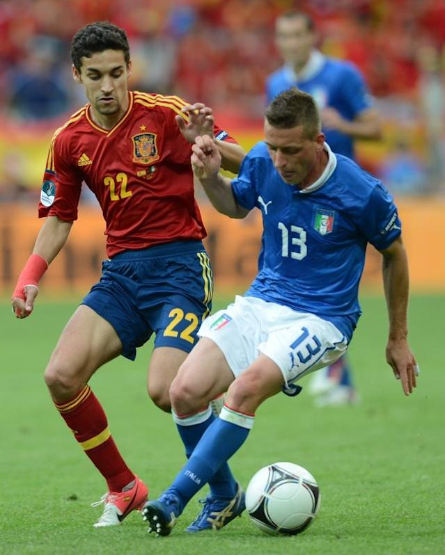 Italian midfielder Emanuele Giaccherini (R) vies with Spanish midfielder Jesus Navas during the Euro 2012 championships football match Spain vs Italy on June 10, 2012 at the Gdansk Arena. AFP PHOTO / CHRISTOF STACHECHRISTOF STACHE/AFP/GettyImages