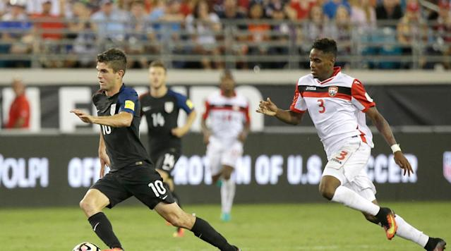 <p>Christian Pulisic blows by Joevin Jones in the USA's 4-0 World Cup qualifying win over Trinidad and Tobago on Sept. 6, 2016, in which he assisted on a goal scored by Jozy Altidore.</p>