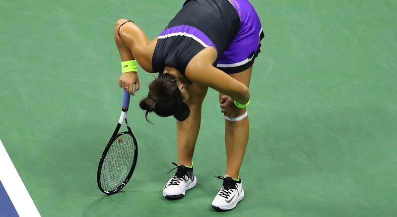 NEW YORK, NEW YORK - SEPTEMBER 05: Bianca Andreescu of Canada grabs her knee during her Women's Singles semi-final match against Belinda Bencic of Switzerland on day eleven of the 2019 US Open at the USTA Billie Jean King National Tennis Center on September 05, 2019 in the Queens borough of New York City. (Photo by Mike Stobe/Getty Images)