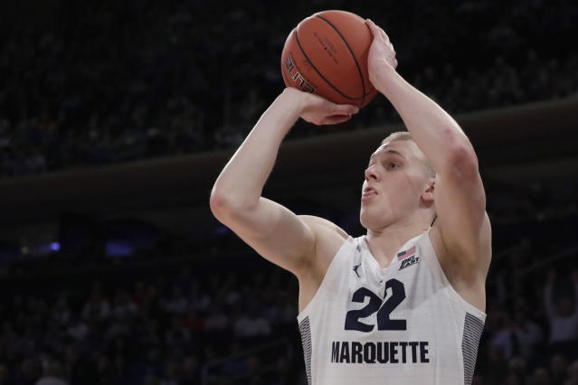 """FILE - In this March 14, 2019, file photo, Marquette forward Joey Hauser shoots against St. John's during the first half of an NCAA college basketball game in the Big East men's tournament, in New York. Michigan State coach Tom Izzo abruptly resigned from a coaches' board Thursday, angered after the NCAA denied an appeal from forward Joey Hauser to play this season. Izzo says the decision led to him resigning from the National Association of Basketball Coaches board of directors because he says the NCAA is making """"arbitrary decisions"""" regarding waiver requests. (AP Photo/Julio Cortez, File)"""