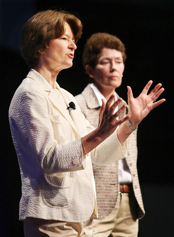 In this June 29, 2008 photo made available by the American Library Association, Sally Ride, foreground, and Tam O-Shaughnessy discuss the role of women in science and how the earth's climate is changing during an ALA conference in Anaheim, Calif. The pioneering astronaut, who relished privacy as much as she did adventure, chose an appropriately discreet manner of coming out. At the end of an obituary that she co-wrote with her partner, Tam O'Shaughnessy, they disclosed to the world their relationship of 27 years. As details trickled out after Ride's death on Monday, July 23, 2012, it became clear that a circle of family, friends and co-workers had long known of the same-sex relationship and embraced it. For many millions of others, who admired Ride as the first American woman in space, it was a revelation - and it sparked a spirited discussion about privacy vs. public candor in regard to sexual orientation. (AP Photo/American Library Association, Curtis Compton)
