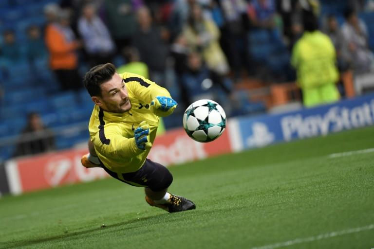 Tottenham Hotspur's goalkeeper Hugo Lloris dives for the ball sduring a warm up before the UEFA Champions League group H football match against Real Madrid October 17, 2017