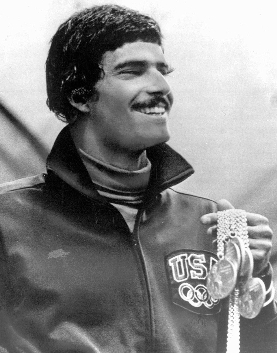 FILE - In this Aug. 31, 1972, file photo, American swimmer Mark Spitz holds five of the seven gold medals he won at the Olympics in Munich, Germany. (AP Photo/Pool, File)