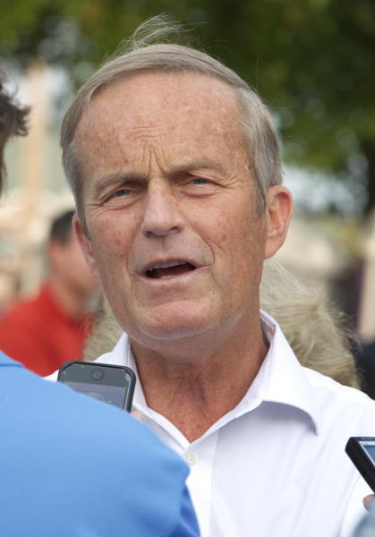 "In this Thursday, Aug. 16, 2012 photograph, Rep. Todd Akin, R-Mo., talks with reporters while attending the Governor's Ham Breakfast at the Missouri State Fair in Sedalia, Mo. Akin was keeping a low profile, Monday, Aug. 20, 2012, a day after a TV interview in which he said that women's bodies can prevent pregnancies in ""a legitimate rape"" and that conception is rare in such cases. (AP Photo/Orlin Wagner)"