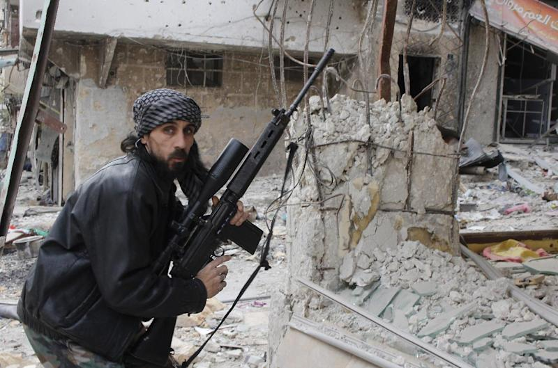 A rebel fighter from the Free Syrian Army holds a position with a Belgium made FAL rifle at a front line in the Salah al-Din neighbourhood of the northern Syrian city of Aleppo, on December 1, 2013