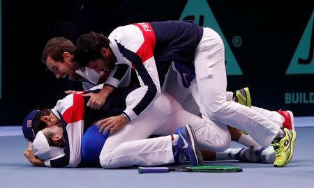 Tennis - Davis Cup Final - France vs Belgium - Stade Pierre Mauroy, Lille, France - November 26, 2017 France's Lucas Pouille celebrates with team mates after winning the Davis Cup and his match against Belgium's Steve Darcis REUTERS/Yves Herman
